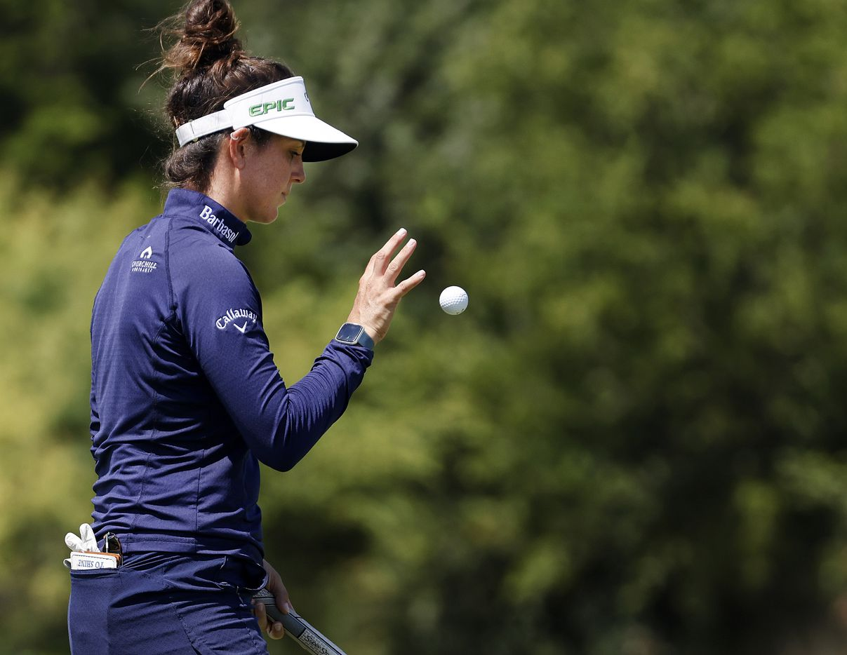 Professional golfer Emma Talley flips her ball after saving par on No. 17 during the opening round of the LPGA VOA Classic at the Old American Golf Club in The Colony, Texas, Thursday, July 1, 2021. Talley finished 6-under. (Tom Fox/The Dallas Morning News)