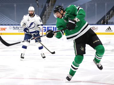 EDMONTON, ALBERTA - SEPTEMBER 28: John Klingberg #3 of the Dallas Stars follows through on his shot as Nikita Kucherov #86 of the Tampa Bay Lightning looks on in the second period of Game Six of the NHL Stanley Cup Final between the Tampa Bay Lightning and the Dallas Stars at Rogers Place on September 28, 2020 in Edmonton, Alberta, Canada. (Photo by Dave Sandford/NHLI via Getty Images)