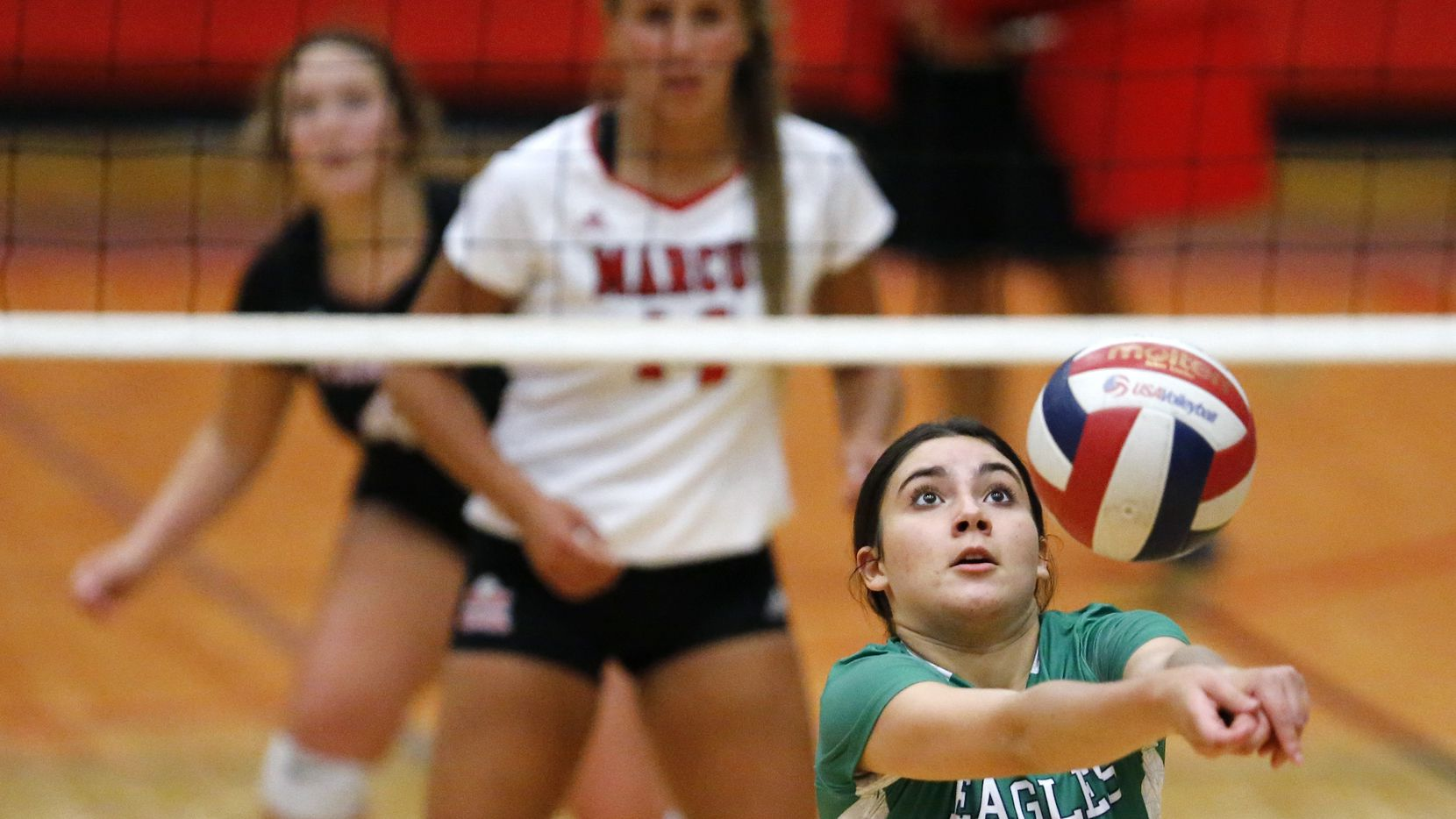 Northwest Eaton's Lorena Gomez keeps a point alive during Tuesday's 25-22, 24-26, 25-18, 25-12 win over Flower Mound Marcus. (Stewart F. House/Special Contributor)