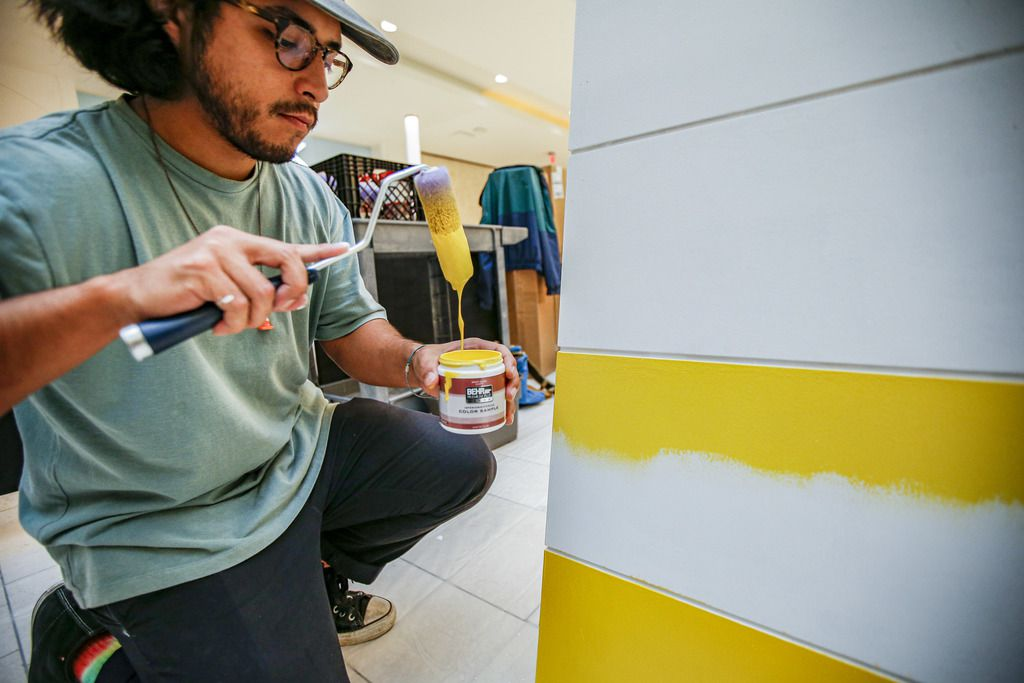 Artist Drigo, Eric Rodriguez, paints his sculpture 'Growing Up' at the Galleria in Dallas, Wednesday, March 11, 2020. (Brandon Wade/Special Contributor)