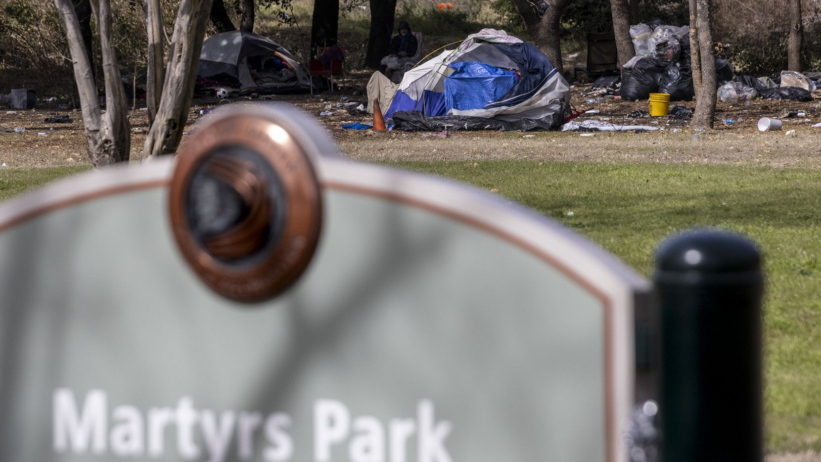"Homelessness encampments at Martyrs Park in downtown Dallas on Feb. 2, 2021. Dr. George Keaton, the head of Remembering Black Dallas, has been a leading voice in the effort to commemorate local victims of racial violence and feels strongly about putting the memorial in Martyrs Park. ""This particular park in my opinion has been redlined just like the communities we live in,"" Keaton said. ""When will [the city] un-redline Martyrs Park? That's what they need to understand."""
