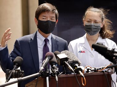 Dallas County Health and Human Services Director Dr. Philip Huang (left) and Dr. Emma Dishner of the North Texas Infectious Diseases Consultants answers questions from the media about the current state of the coronavirus Delta variant outside the County Health building in Dallas, Tuesday, August 10, 2021. (Tom Fox/The Dallas Morning News)