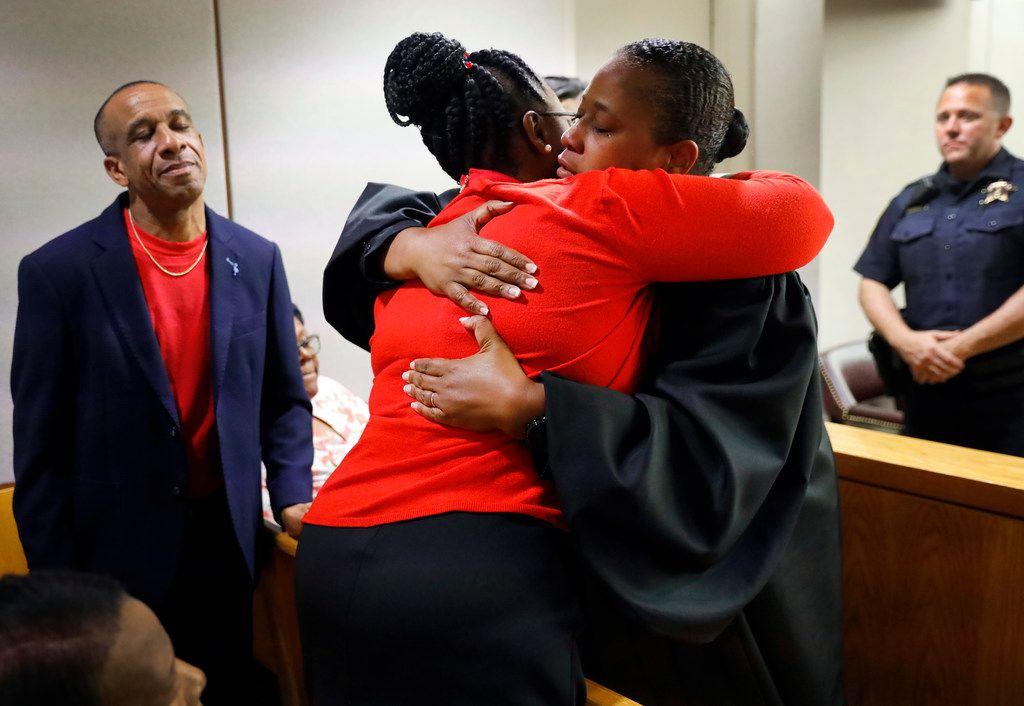 Allison Jean hugged state District Judge Tammy Kemp while her husband, Bertrum Jean, stood nearby.