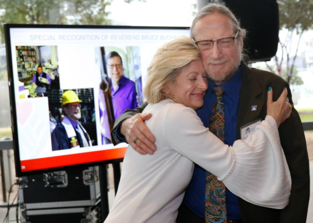 Camille Grimes, executive director, The Dallas Morning News Charities, hugs the Rev. Bruce Buchanan, executive director of The Stewpot, after he was honored for his 30 years of service during the Dallas Morning News Charities kick-off event at the Winspear Opera House on Wednesday.