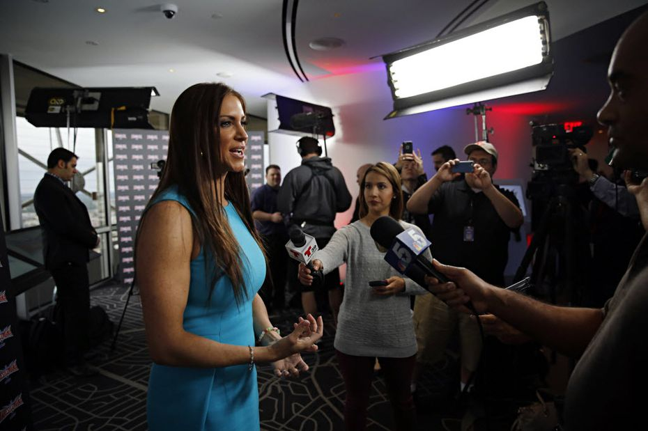 Stephanie McMahon (left), Chief Brand Officer of WWE talks to media during a press event Friday, April 1, 2016 at Reunion Tower in downtown Dallas.
