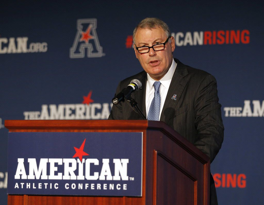 FILE - In this Aug. 4, 2015 file photo, American Athletic Conference commissioner Mike Aresco addresses reporters during AAC media day in Newport, R.I. (AP Photo/Stew Milne, File)