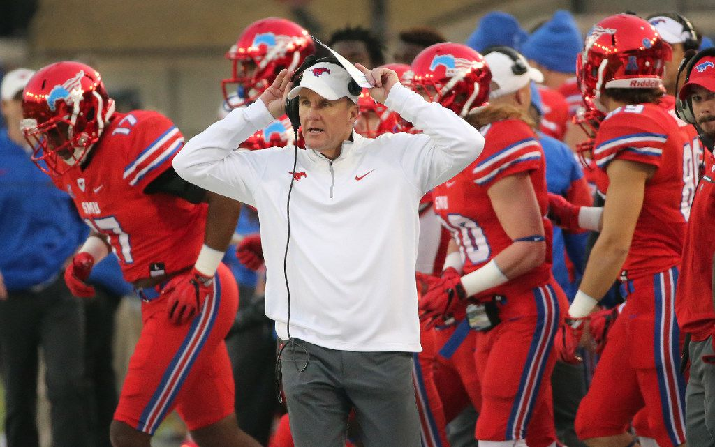 SMU head coach Chad Morris is pictured during the Navy Midshipmen vs. the SMU Mustangs NCAA football game at Ford Stadium in Dallas on Saturday, November 26, 2016. (Louis DeLuca/The Dallas Morning News)