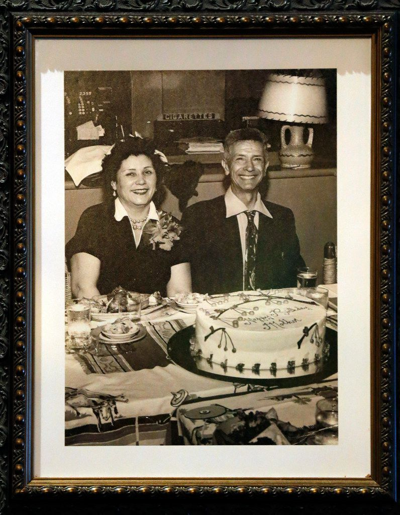 "Miguel ""Mike"" Martinez and his wife Faustina Porras Martinez smile in an undated photo hanging on the wall of El Fenix. The restaurant group is throwing a 100th birthday party on Sept. 13, 2018."