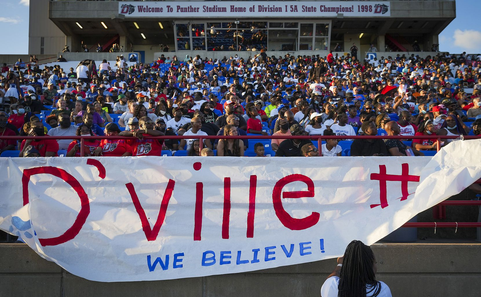 Duncanville students hand a banner before a high school football game against Mater Dei on Friday, Aug. 27, 2021, in Duncanville. (Smiley N. Pool/The Dallas Morning News)