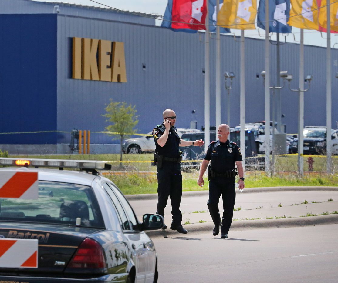 Grand Prairie police officers are pictured at the Ikea store in Grand Prairie after an armed confrontation.
