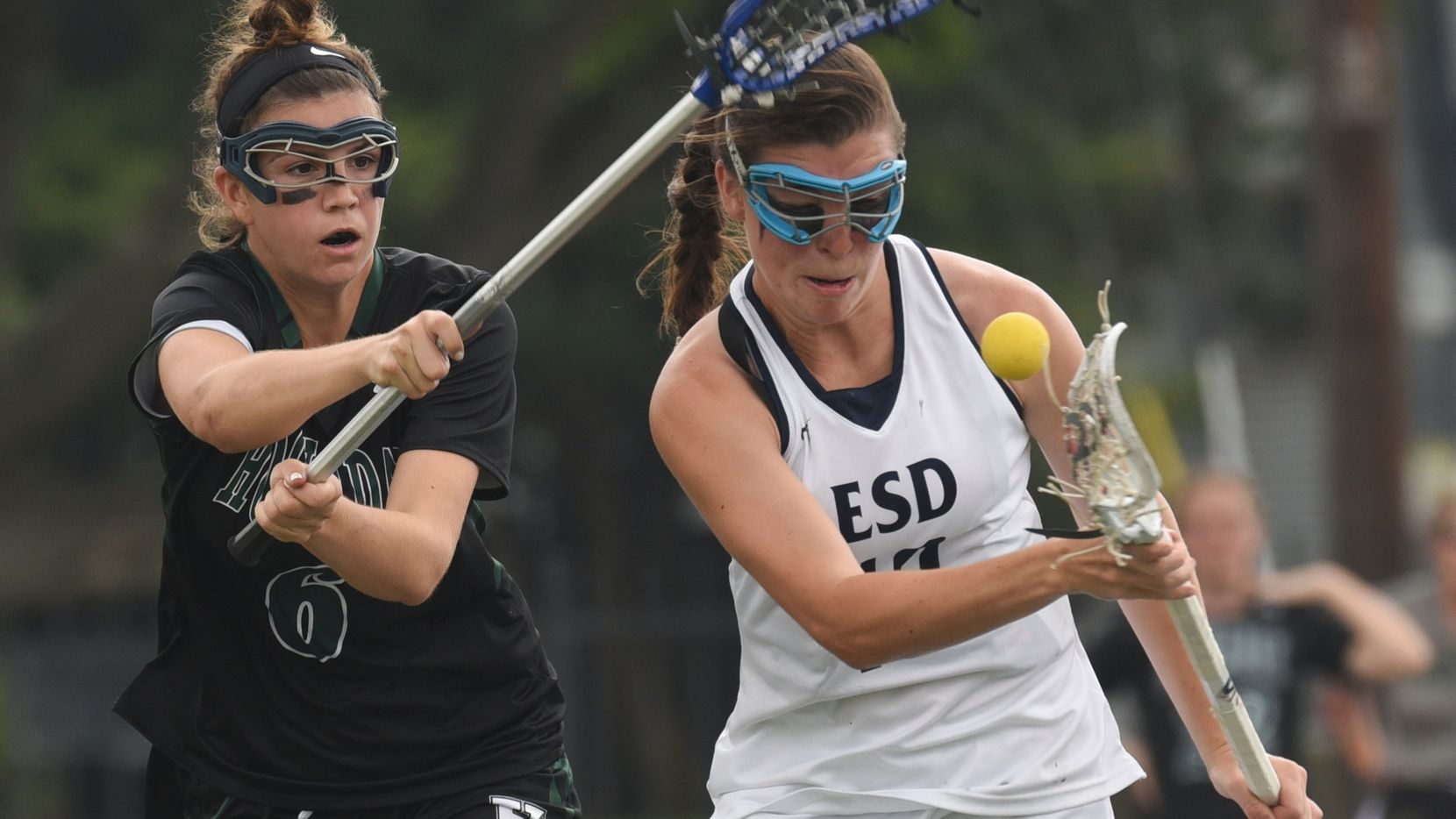 Hockaday's Kate Love (6), left, and ESD's Charlotte North (10) fight for the ball during their championship lacrosse game at Jones Stadium on Saturday, April 29, 2017.