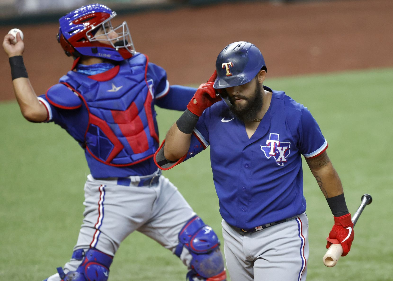 Texas Rangers batter Rougned Odor walks to the dugout after striking out during a simulated Summer Camp game inside Globe Life Field in Arlington, Texas, Thursday, July 9, 2020. (Tom Fox/The Dallas Morning News)
