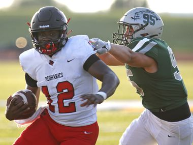 Frisco Liberty quarterback Keldric Luster (12) gets past Frisco Reedy defensive tackle Chase Miller for a touchdown during the first half of a game at David Kuykendall Stadium in Frisco on August 26, 2021. (Stewart F. House/Special Contributor)