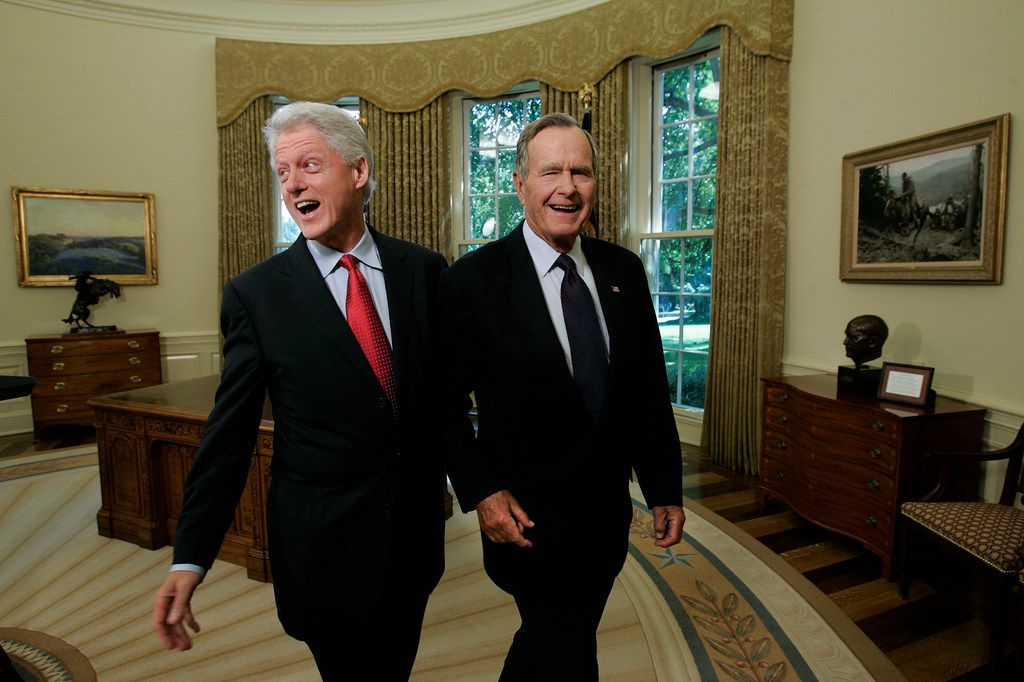 Former Presidents Bill Clinton and George H.W. Bush in the Oval Office after a joint statement with President George W. Bush regarding Hurricane Katrina relief in Washington on Sept. 1, 2005.