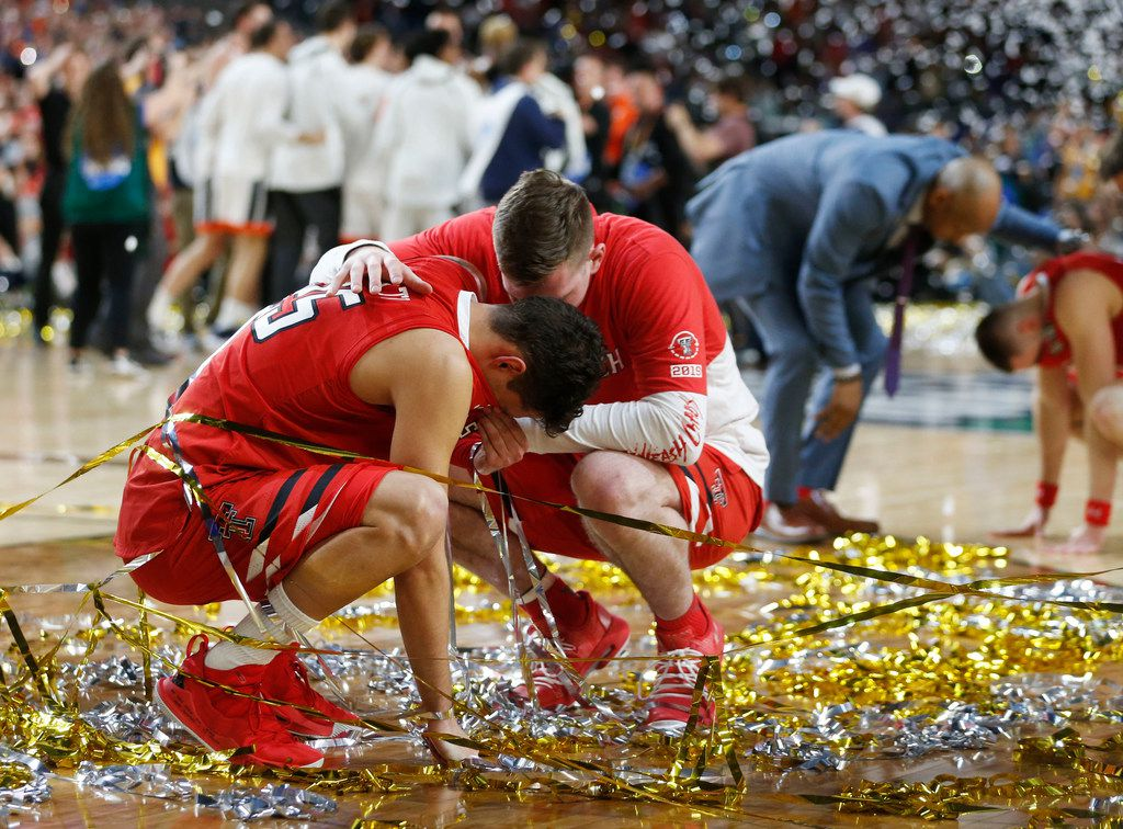 Texas Tech Red Raiders guard Davide Moretti (25) is consoled by a teammate after losing to Virginia Cavaliers 85-77 in overtime in the Final Four championship game of the NCAA men's college basketball tournament at U.S. Bank Stadium in Minneapolis on Monday, April 8, 2019. (Vernon Bryant/The Dallas Morning News)