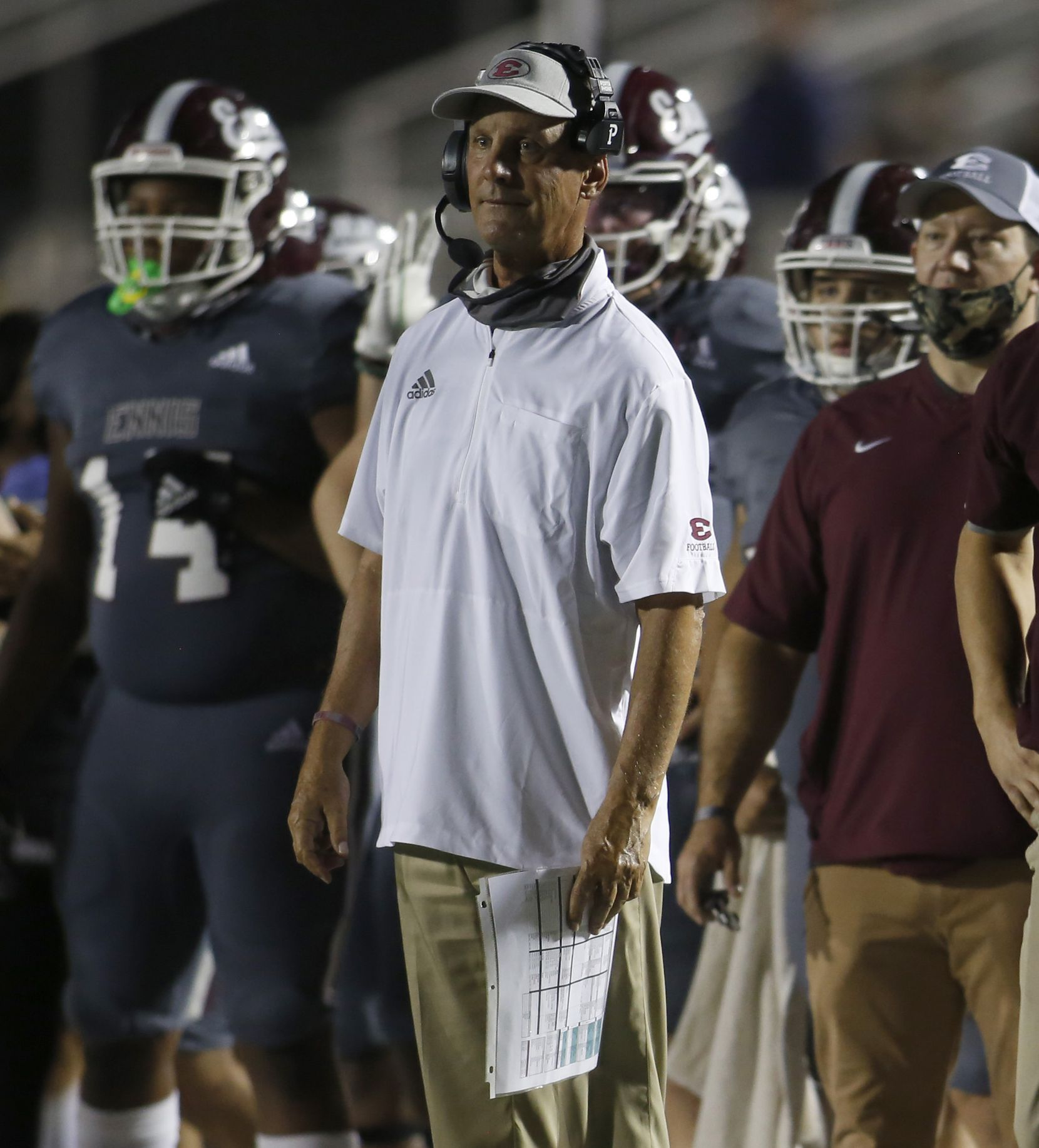 Ennis head coach Sam Harrell looks on from the Lions sidelines during first half action against Mansfield Summit. The two teams played their non-district football game at  Lions Stadium on the campus of Ennis High School in Ennis on October 22, 2020. (Steve Hamm/ Special Contributor)