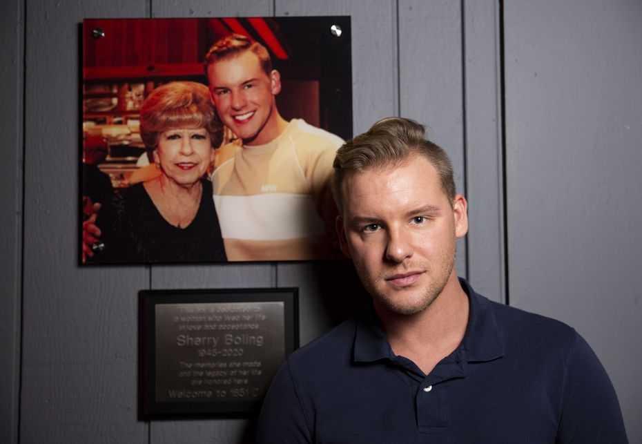 1851 Club owner Dalton Haynes next to the plaque honoring his grandmother. Haynes, once a longtime customer, said he bought the Arlington bar in memory of her.