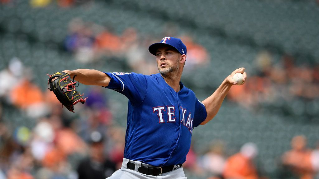 Texas Rangers starting pitcher Mike Minor delivers a pitch during the first inning of a baseball game against the Baltimore Orioles, Sunday, Sept. 8, 2019, in Baltimore.