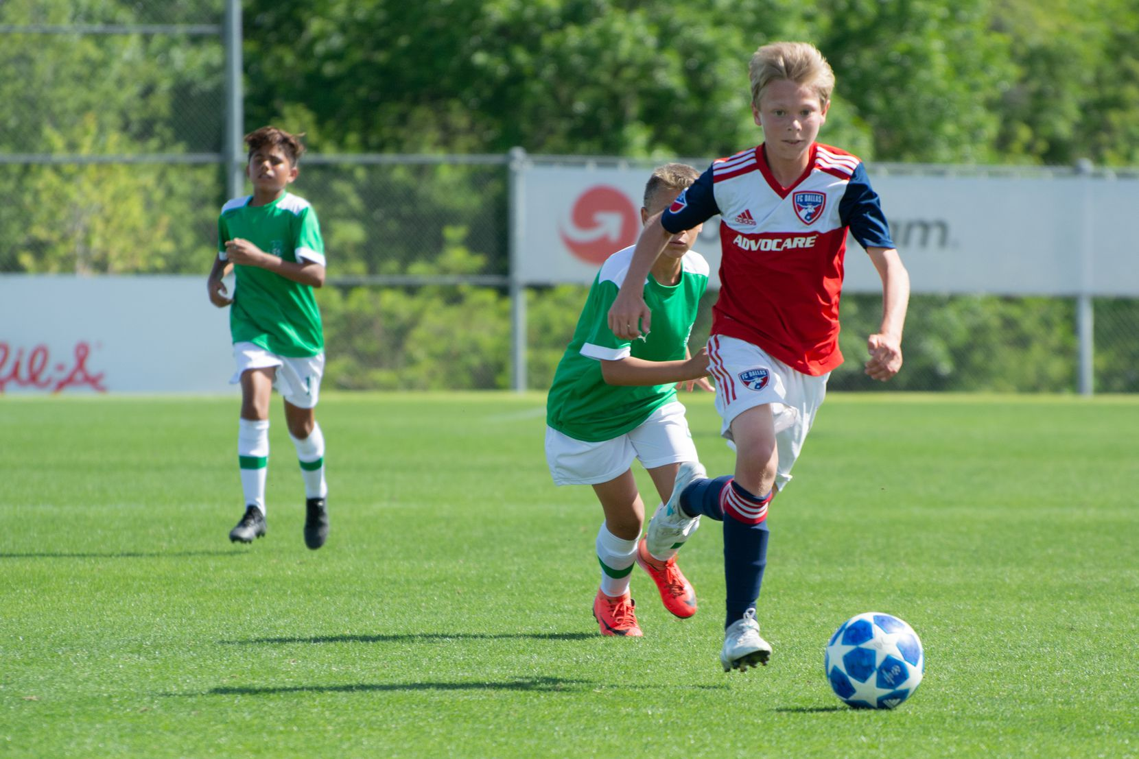 Nolan Norris dribbles against Ikapa United in the 2019 Dallas Cup Super 14s.