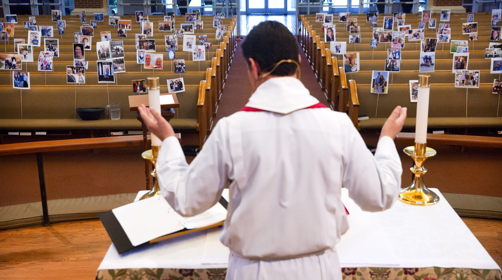 Father Clayton Elder rehearsed his Holy Thursday service in front of a sanctuary full of parishioners' photos in April before going live on YouTube at St. Philip Episcopal Church in Frisco.