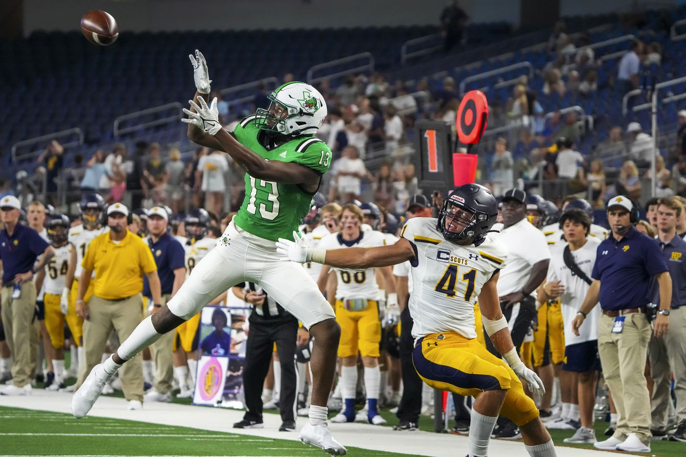 Southlake Carroll wide receiver RJ Maryland (13) reaches for a pass as Highland Park's George Wright (41) defends during the second half of a high school football game at AT&T Stadium on Thursday, Aug. 26, 2021, in Arlington.