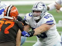 Cowboys center Tyler Biadasz (63) blocks Browns defensive end Porter Gustin (97) during the third quarter of a game at AT&T Stadium in Arlington on Sunday, Oct. 4, 2020.