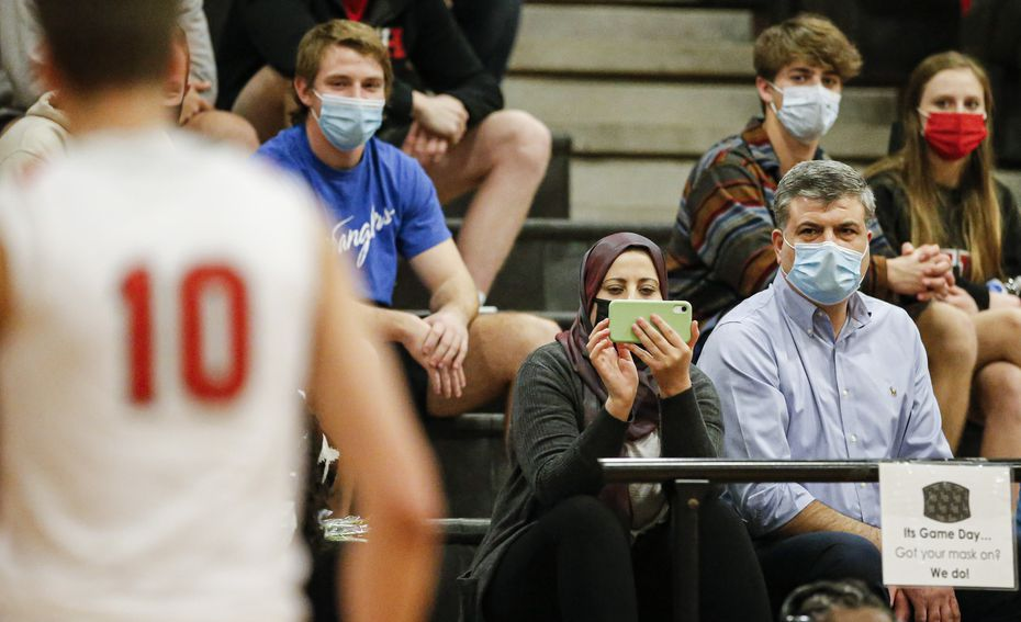 Maher, right, and Fatima Shamait, left, watch their son, Lake Highlands senior forward Mohamad Shamait (10), during a high school basketball game against Irving Nimitz, Friday, February 5, 2021. Lake Highlands won 75-45. Shamait and his family originally lived in Syria but fled to escape civil war within the country. They moved to Jordan, before finally arriving in the United States.