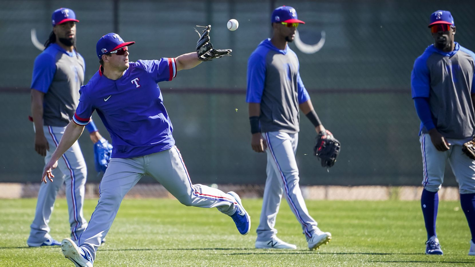 Texas Rangers infielder Nick Solak makes a catch while participating in a fielding drill during a spring training workout at the team's training facility on Thursday, Feb. 20, 2020, in Surprise, Ariz.