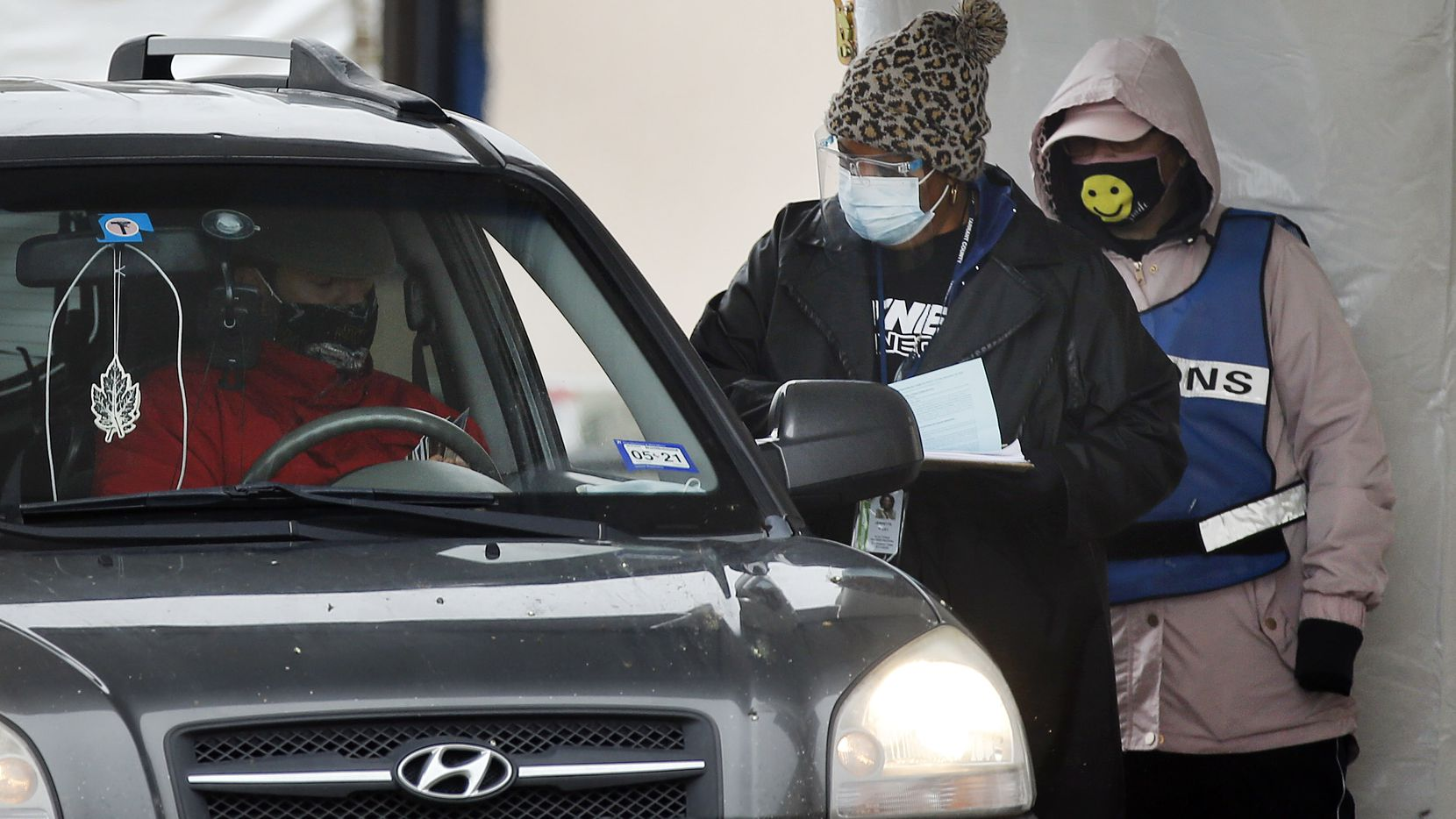 Ulysses Rusher (in vehicle) attempts to drop off his mothers early voting ballot at the Tarrant County Elections Center in Fort Worth, Tuesday, October 27, 2020. Officials wouldn't let him do it without his mother present. He said he will try to bring her with him on Wednesday. (Tom Fox/The Dallas Morning News)