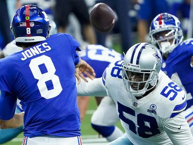 FILE - Giants quarterback Daniel Jones (8) gets a pass off under pressure from Cowboys defensive end Aldon Smith (58) during the second quarter of a game at AT&T Stadium on Sunday, Oct. 11, 2020, in Arlington.
