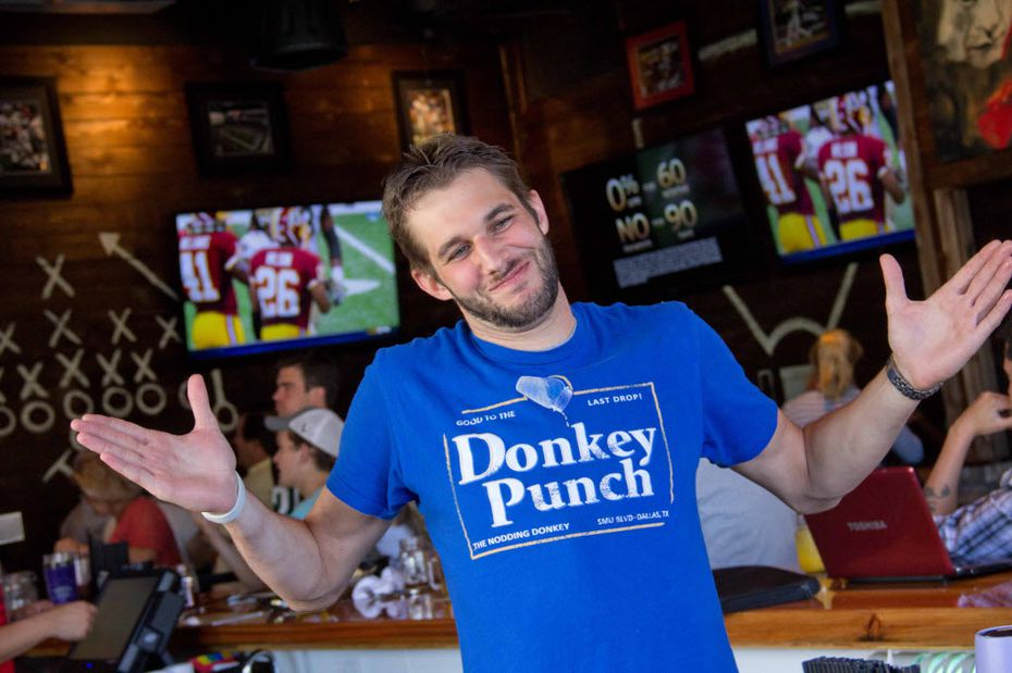 Sage Bueltel, photographed in 2012, wears a shirt touting the Nodding Donkey's famous — and potent — brand of jungle juice