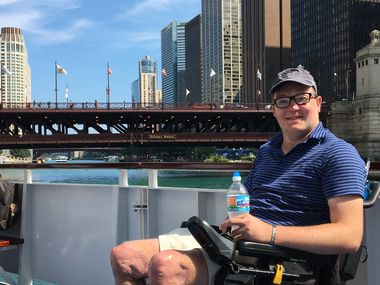Wheelchairtravel.org blogger John Morris is shown during a trip to Chicago. Morris says a new American Airlines policy restricts many motorized wheelchairs from regional aircraft.