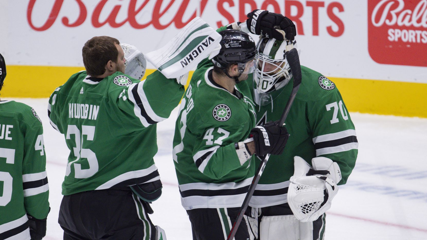 Dallas Stars right wing Alexander Radulov (47) celebrates with Dallas Stars goaltender Braden Holtby (70) after their preseason game win against St. Louis Blues on Tuesday, Oct. 5, 2021, at American Airlines Center in Dallas.