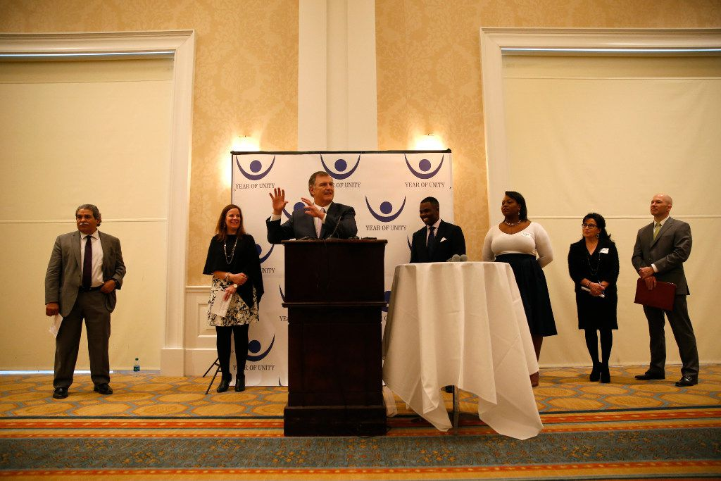 Dallas Mayor Mike Rawlings, honorary co-chair of the Year of Unity, voices his support for the initiative and encourages Dallas residents to do their part to improve cultural and race relations in the city. (Rose Baca/The Dallas Morning News)