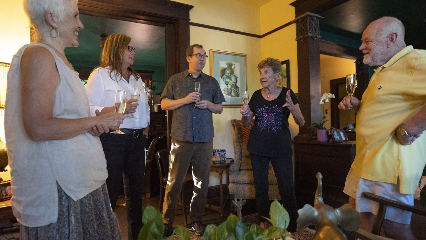 Martha Heimberg (second from right) and her husband, Ron Sekerak (right), celebrate seeing family friend Terri Raith (from left), daughter Jessica Heimberg and her husband, Steve Paul, before a small dinner.