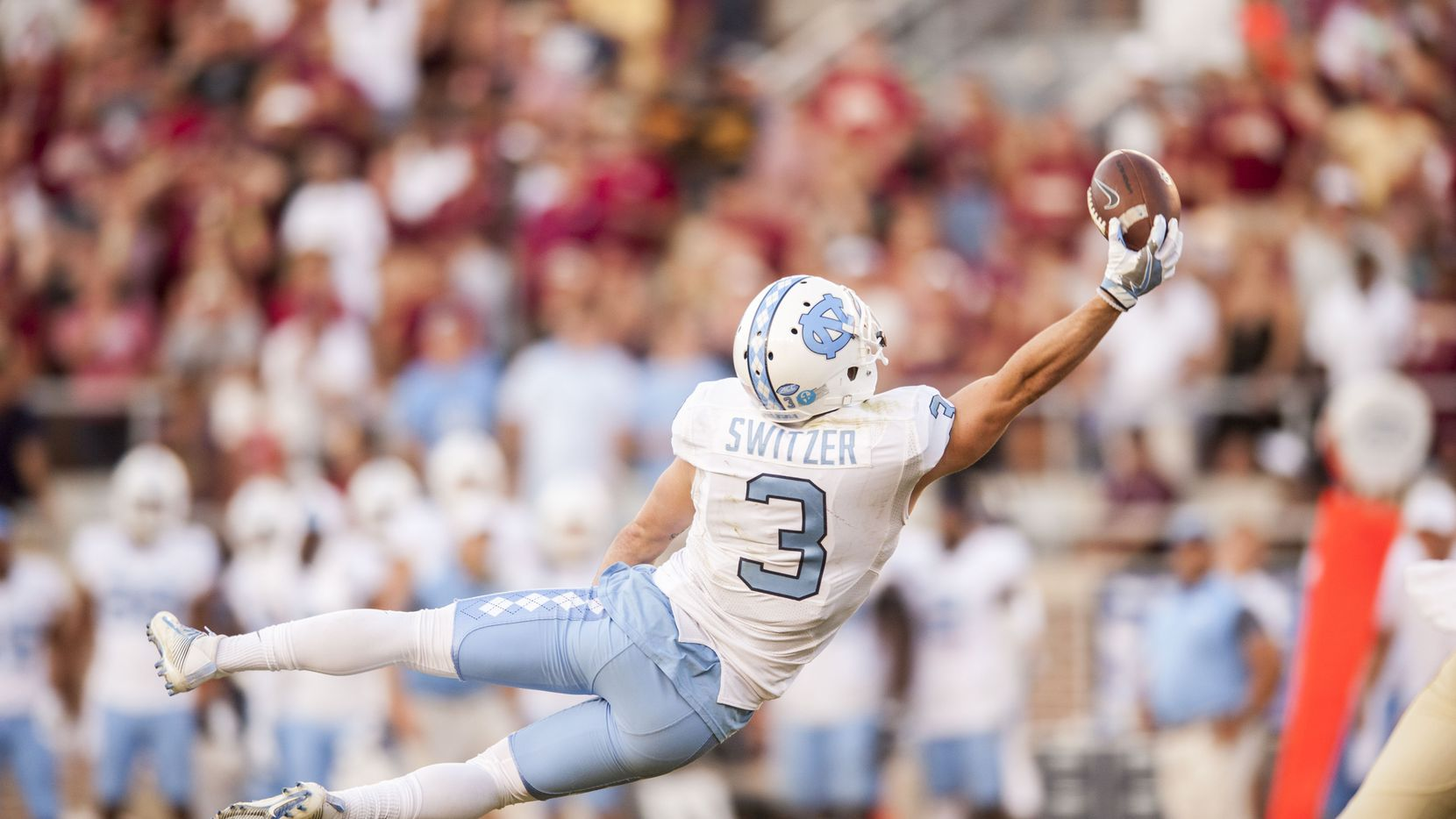 TALLAHASSEE, FL - OCTOBER 01: Ryan Switzer #3 of the North Carolina Tar Heels stretches out in an attempt to make a catch against the Florida State Seminoles at Doak Campbell Stadium on October 1, 2016 in Tallahassee, Florida. (Photo by Jeff Gammons/Getty Images)