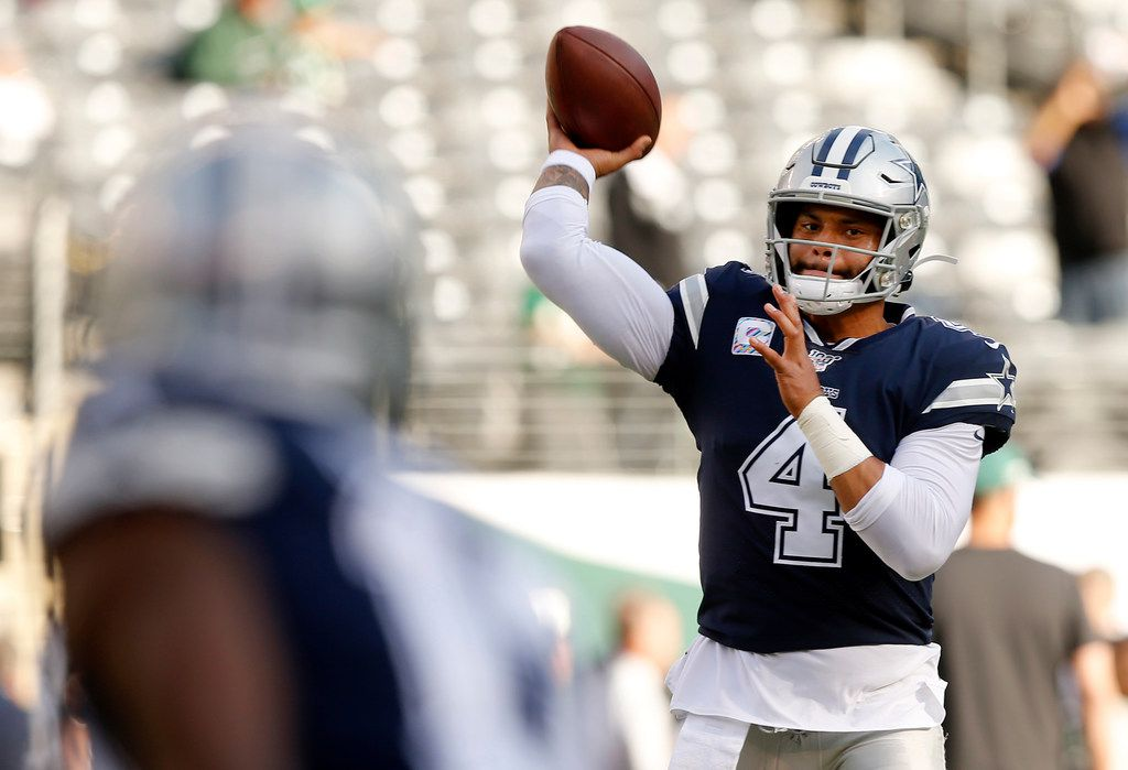 Dallas Cowboys quarterback Dak Prescott (4) throws a warmup pass to wide receiver Michael Gallup before their game with the New York Jets at MetLife Stadium in East Rutherford, New Jersey, Sunday, October 13, 2019. (Tom Fox/The Dallas Morning News)
