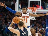 New York Knicks guard Frank Ntilikina (11) defends against Dallas Mavericks guard Luka Doncic (77) during the second half of an NBA basketball game at American Airlines Center on Friday, Nov. 8, 2019, in Dallas.