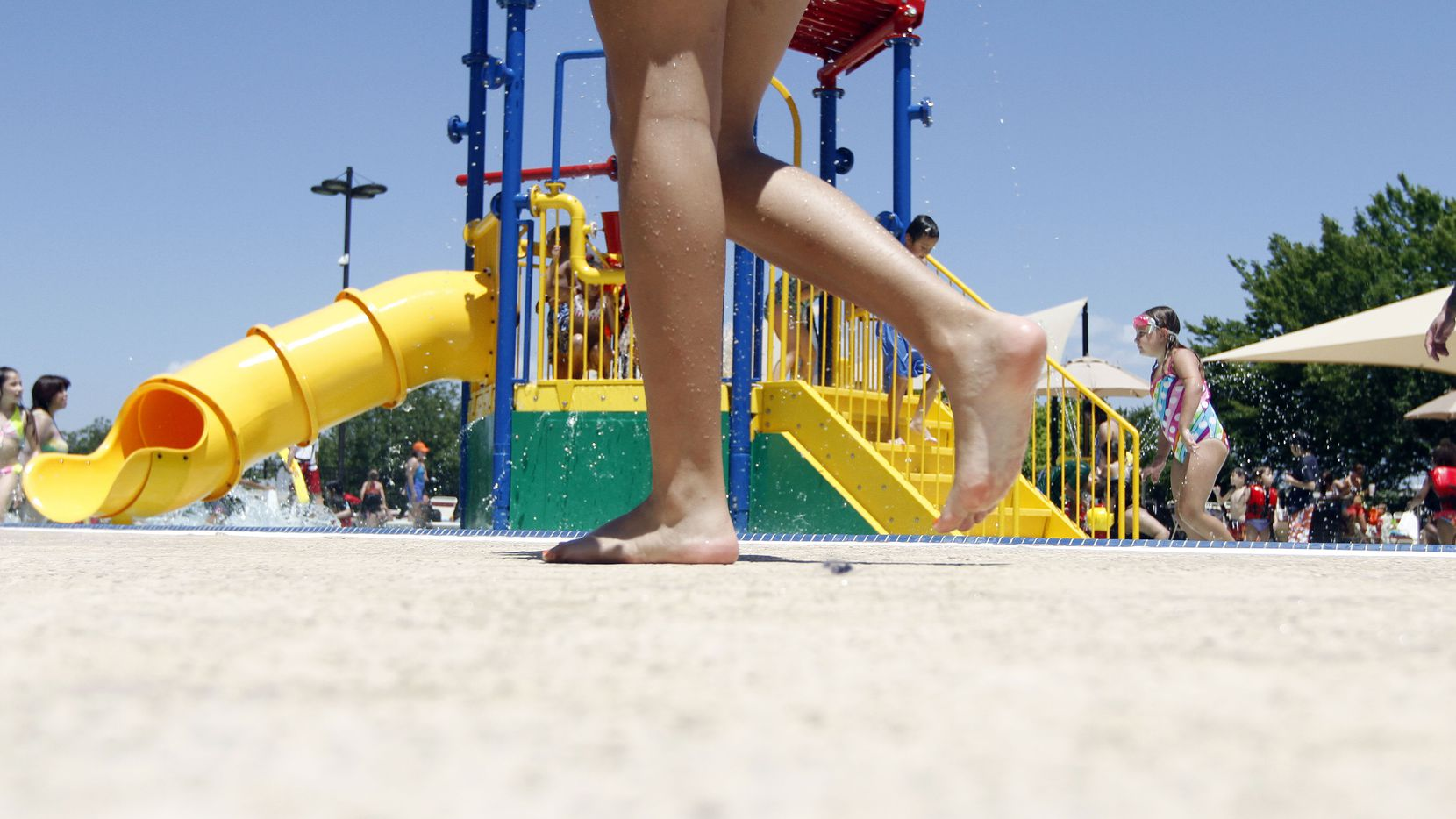 Parents and children alike enjoyed themselves at the West Irving Aquatic Center in 2010.