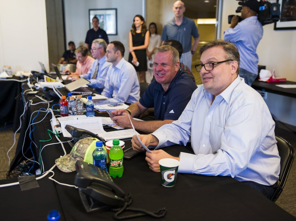 Dallas Mavericks general manager Donnie Nelson (right) talks draft picks in their draft room during the Dallas Mavericks 2016 NBA draft party on Thursday, June 23, 2016 at the American Airlines Center in Dallas.  (Ashley Landis/The Dallas Morning News)