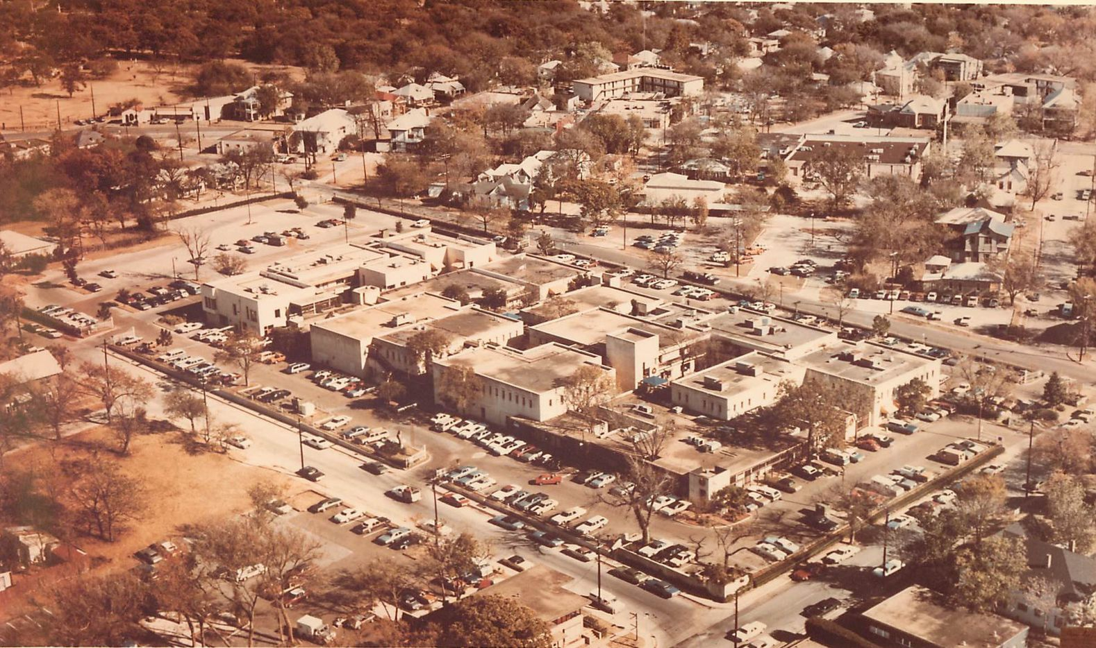 When the Quadrangle opened in 1966, what's now Uptown was a sleepy neighborhood of old homes and vacant lots.