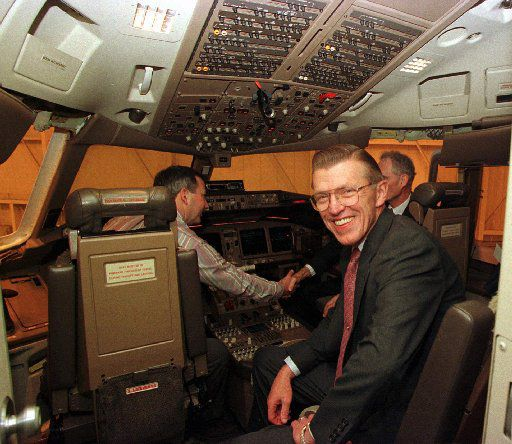Crandall, chairman of American Airlines parent AMR Corp., smiles from the cockpit of a Boeing 777, in an American Airlines hanger following a news conference Thursday, Nov. 21, 1996, in Grapevine, Texas.