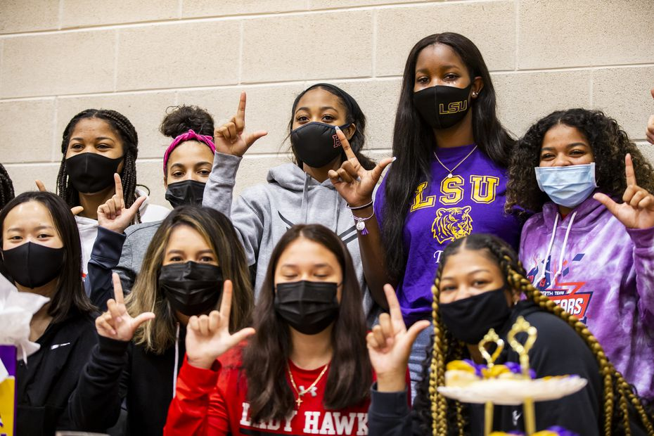 Rockwall-Heath girls basketball player Logyn McNeil, back row - second from right, poses for photos with her teammates during signing day at Rockwall-Heath High School in Heath, Wednesday, November 11, 2020. McNeil signed with Louisiana State University.