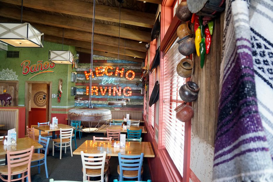 """In one of the side rooms at the first Lupe Tortilla in North Texas, a light-up sign says """"hecho en Irving,"""" which translates to """"made in Irving."""""""