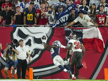 Dallas Cowboys wide receiver Michael Gallup (13) can't make a catch in the end zone as Tampa Bay Buccaneers cornerback Jamel Dean (35) defends during the first half of an NFL football game at Raymond James Stadium on Thursday, Sept. 9, 2021, in Tampa, Fla.