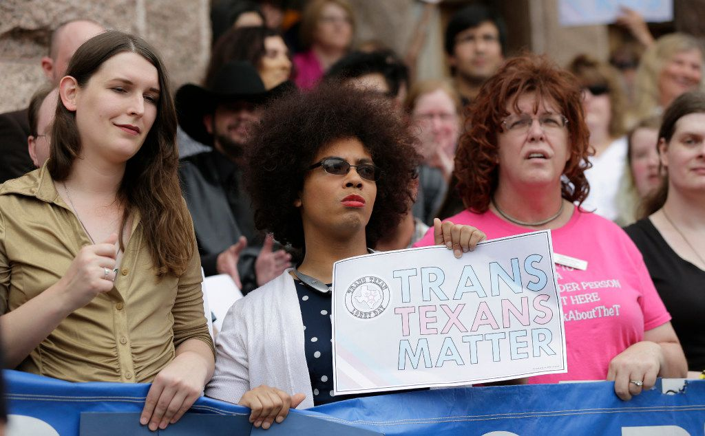 """Members of the transgender community take part in a rally on the steps of the Texas Capitol, Monday, March 6, 2017, in Austin, Texas. The group is opposing a """"bathroom bill"""" that would require people to use public bathrooms and restrooms that correspond with the sex on their birth certificate. (AP Photo/Eric Gay)"""
