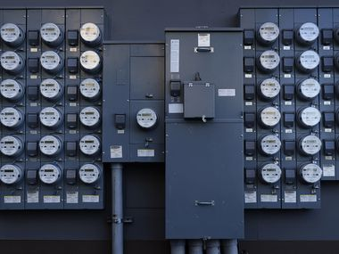 Rows of apartment electrical meters line a wall near downtown Dallas on Wednesday, June 30, 2021.