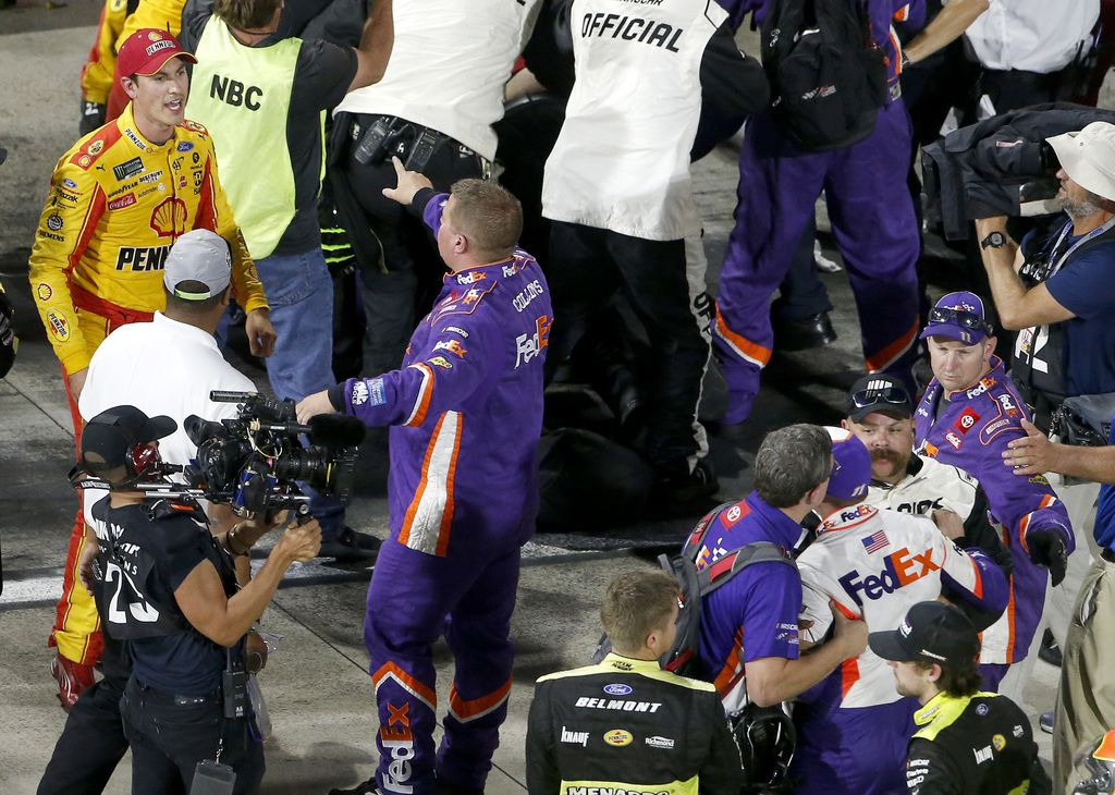 MARTINSVILLE, VIRGINIA - OCTOBER 27: Denny Hamlin (bottom right, back to camera), driver of the #11 FedEx Freight Toyota, and Joey Logano (top left ), driver of the #22 Shell Pennzoil Ford, and their crews have an altercation on pit lane following the Monster Energy NASCAR Cup Series First Data 500 at Martinsville Speedway on October 27, 2019 in Martinsville, Virginia. (Photo by Brian Lawdermilk/Getty Images)