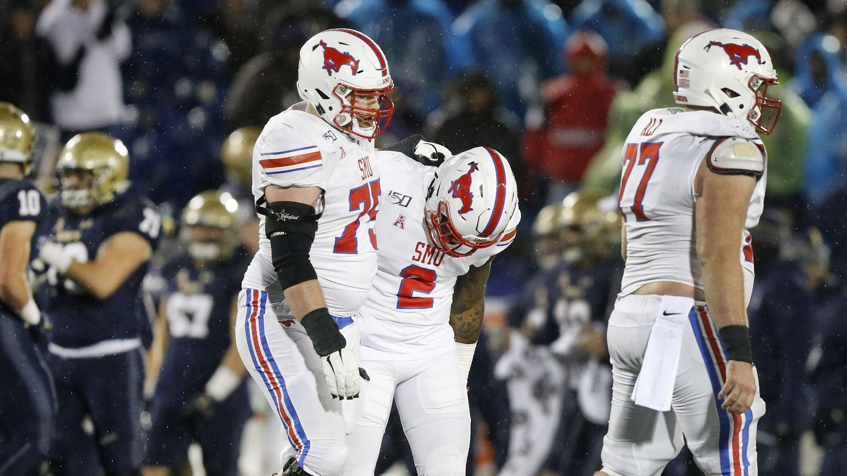 Southern Methodist Mustangs offensive lineman Hayden Howerton (75) consoles running back Ke'Mon Freeman (2) after they failed to convert on fourth down late in the fourth quarter against the Navy Midshipmen at Navy-Marine Corps Memorial Stadium in Annapolis, Maryland, Saturday, November 23, 2019. The Mustangs lost, 35-28.