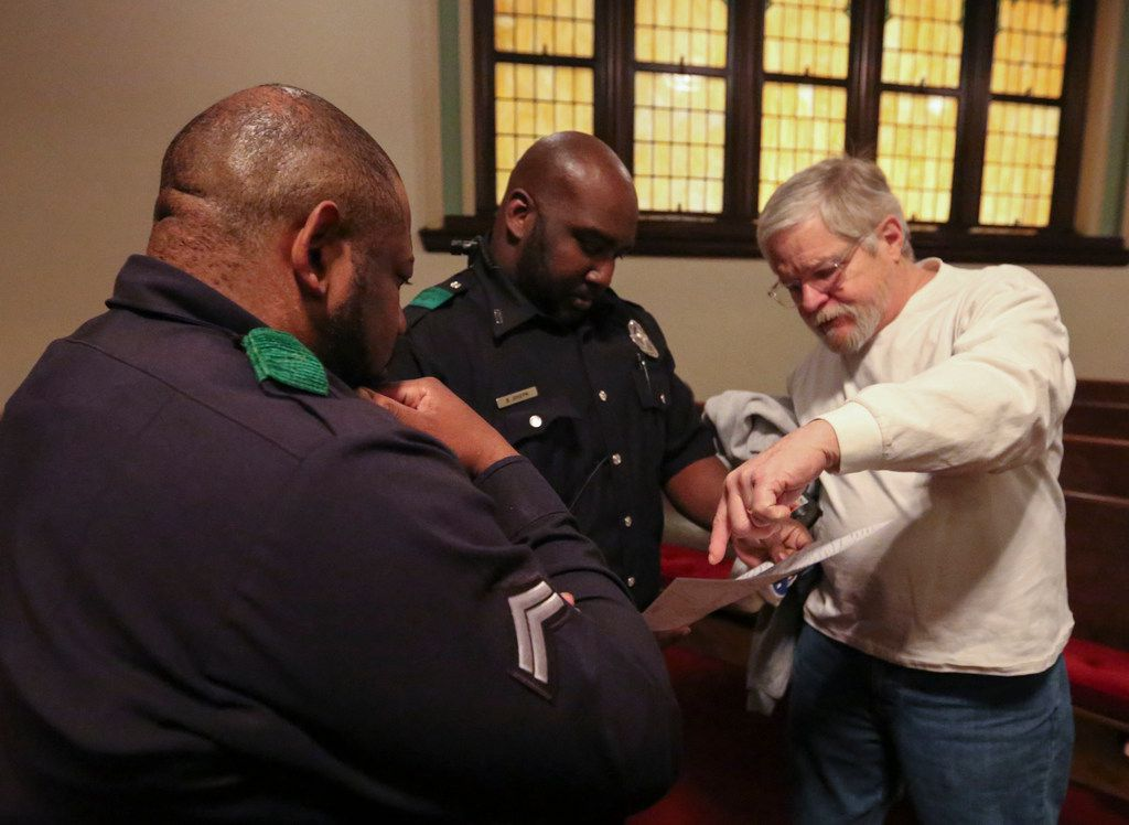 Detective M. Stampley (from left), Officer B. Joseph and volunteer Dennis Friedel figure out where to start in their assignment area to count the homeless with the Metro Dallas Homeless Alliance.